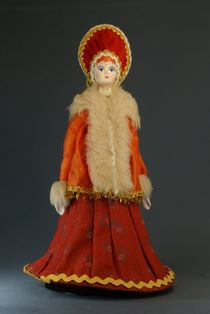 Doll gift porcelain. The woman in the fur coat and the headdress. Late 19th - early 20th century Russia.