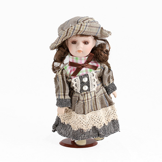 Doll porcelain Girl brunette brown and beige dress in a cage