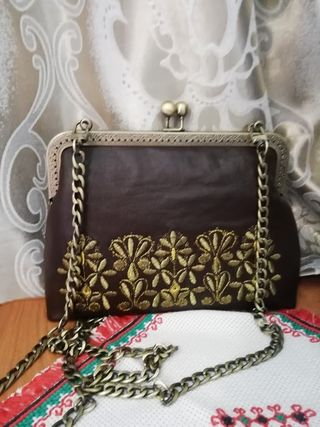 Handbag made of genuine leather with gold embroidery