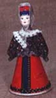 Doll gift porcelain. A woman in a traditional costume. 18-19 centuries Russia.
