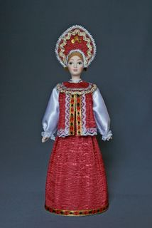 Doll gift porcelain. The North Of Russia. Maiden, traditional Russian costume.