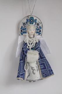 Doll pendant souvenir porcelain. Snow Maiden. Fairytale character.