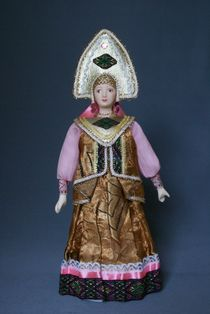 Doll gift porcelain. Russian folk costume with desagree.