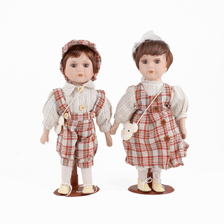 Doll porcelain Pair of beige and red suits in a cage
