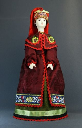 Doll gift porcelain. Kiev lips. Russia. Women's festive costume. The late 19th century and early 20th century