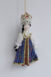 Hawthorn in a sundress. Russian traditional costume. Suspension