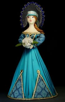 Doll gift porcelain. Lady in summer dress with bunch of flowers. 19th century.