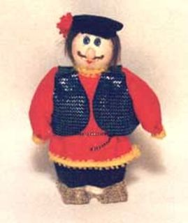 Doll-poteshka gift pendant. Ofen. The little man in peasant clothes. Wood, textiles.