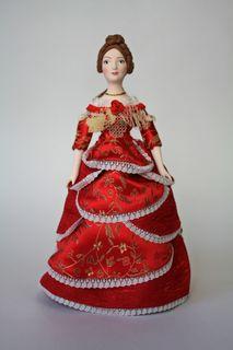 Doll pendant souvenir porcelain. Lady in a ball gown.