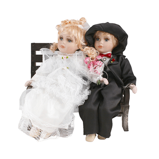 Porcelain dolls on a bench the Bride and Groom 30x30 cm