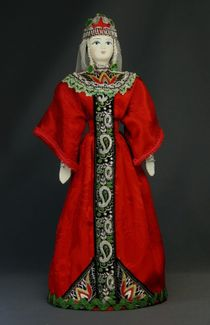 Doll gift. Ancient Princess in festive attire.