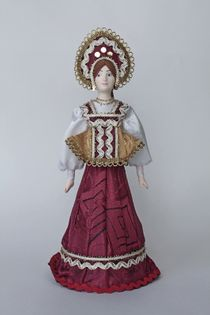 Doll gift porcelain. The Archangel's lips. Maiden costume. Late 19th - early 20th century.