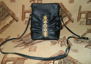 "Bag ""Accordion"" made of genuine leather with gold embroidery black"