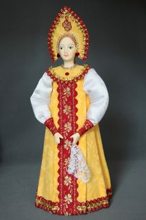Doll gift porcelain. Traditional maiden costume.
