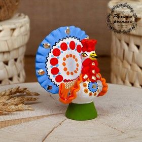Dymkovo clay toy, the Turkey painted with blue tail