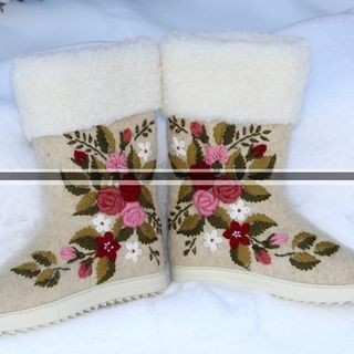 Women's felt boots made of natural sheep wool with embroidery and painting
