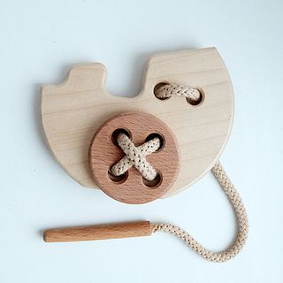 "Lacing ""Steamboat"" - developing children's wooden toy"