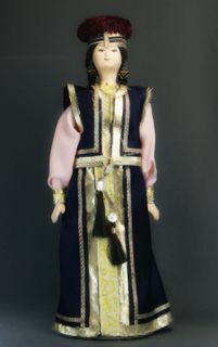 Doll gift porcelain. Astrakhan lips. Kalmyk festive costume women. Late 19th - early 20th century.