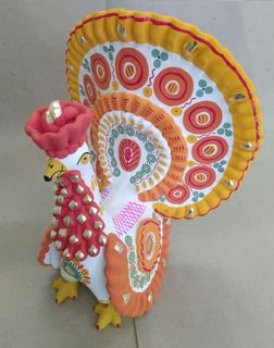 Dymkovo clay toy, the Turkey painted with yellow tail