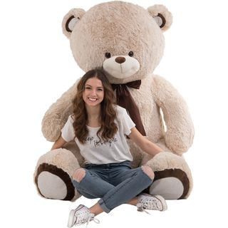 Huge teddy bear with ribbon