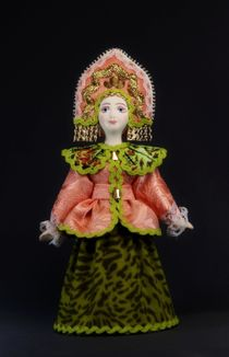 Doll gift porcelain. Russia. The women's traditional winter suit (styling).