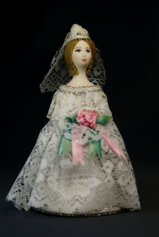 Doll gift porcelain. The bride in a wedding gown. The European fashion.