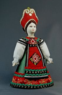 Doll gift porcelain. Ryazan province. Russia. Girl in traditional costume. The late 18th and early 19th century.