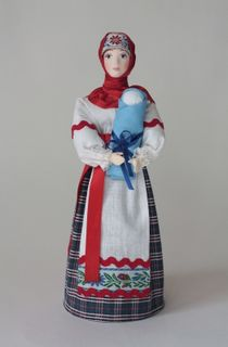 Doll gift porcelain. Peasant woman with a child.