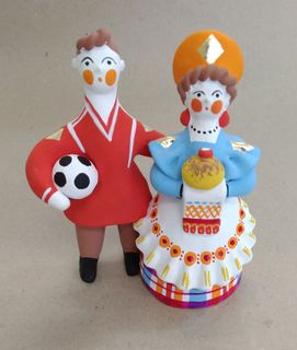 Dymkovo clay toy football Player and a lady