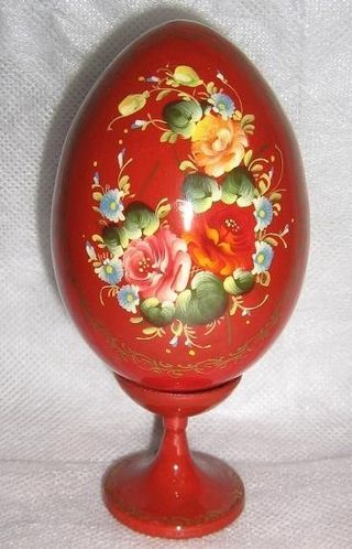 Egg decorative with hand painted and lacquered on a leg 140 mm high