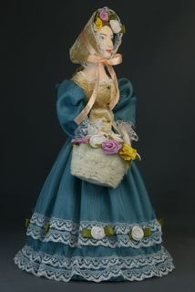 Lady in a secular dress with a basket of flowers. The beginning of the 19th century. Petersburg. Doll gift