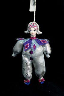 Doll pendant souvenir porcelain. Harlequin. Theatrical character.