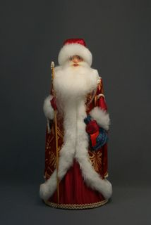 Porcelain souvenir doll. Santa Claus in a bitch. Fairytale character.