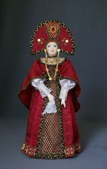 Doll gift porcelain. Russian beauty in traditional festive attire