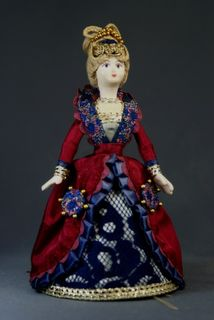 Doll gift porcelain. Fantasy on the theme of the secular dress. 17th century. Europe.