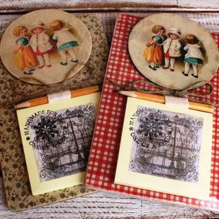 Souvenir fridge magnet with a notebook. Three Kids Vintage, mix background.