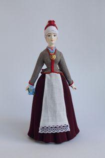 Doll gift. Estonian women's costume of the 19th century. Region: Pernumee