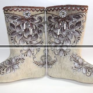 Boots for women from natural sheep wool with embroidery