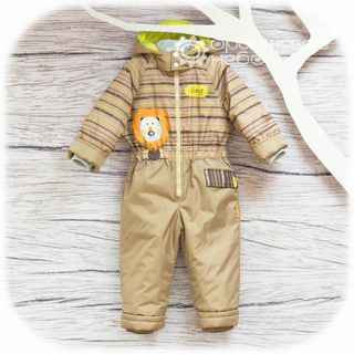 Demi-season overalls for kids from waterproof fabric on a lining from cotton