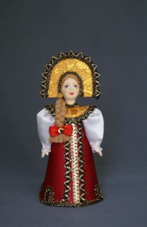 Doll gift porcelain. Girl in traditional Russian attire.