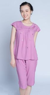 Pink women's flower pajamas with elongated shorts