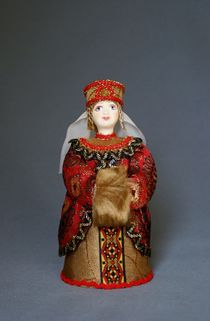 Doll gift porcelain. Princess in a traditional Russian outfit with a clutch.