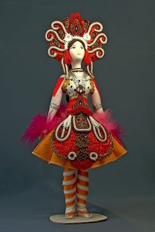 Doll gift porcelain. The Golden bird.Theatrical costume at the ESC. Leon Bakst.