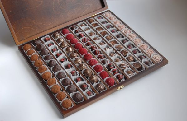 Set of 100 handmade chocolates in a wooden box