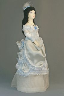 Doll gift porcelain. Dress of the 1860s. Europe.