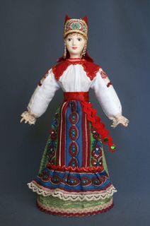 Doll gift porcelain. Ryazan province. Russia. Women's festive costume. 19th and early 20th century.
