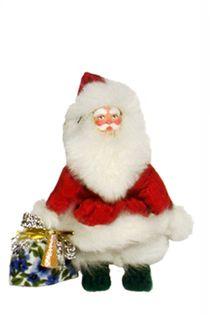 Doll pendant souvenir porcelain. Santa Claus. Fairy tale character.