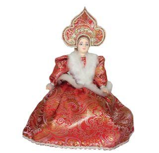 Porcelain doll maker in red dress