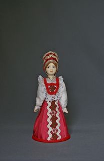 Doll gift porcelain. Traditional girl suit