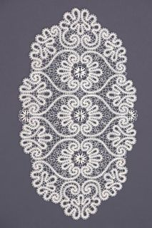 Doily lace oval with flower pattern
